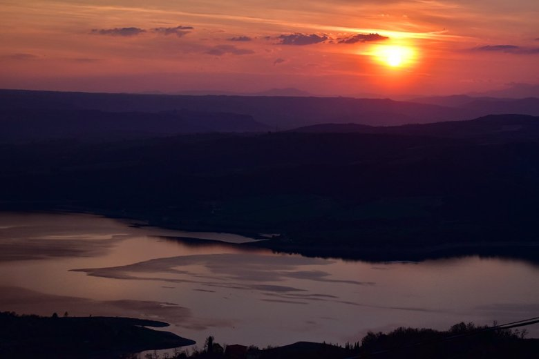 From Civitella Del Lago you can see the sun set behind Lake Corbara