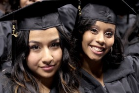 Two young female African-American college graduates.