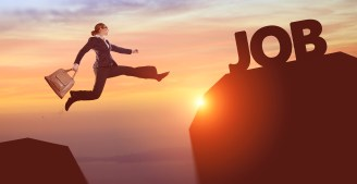 "Businesswoman jumping from one rock up to another, with the word ""job"" as the goal."
