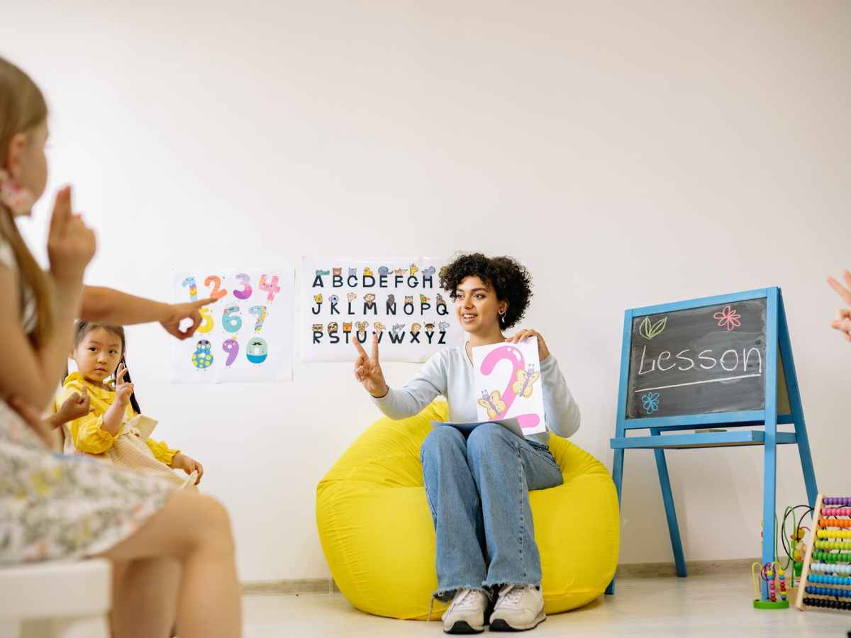 woman teaching children about numbers