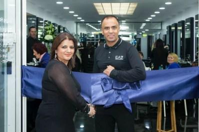 Rush Birmingham franchisees cutting the ribbon to open their Rush salon.
