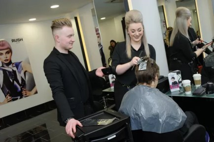 Rush Ipswich stylists with a client on opening day