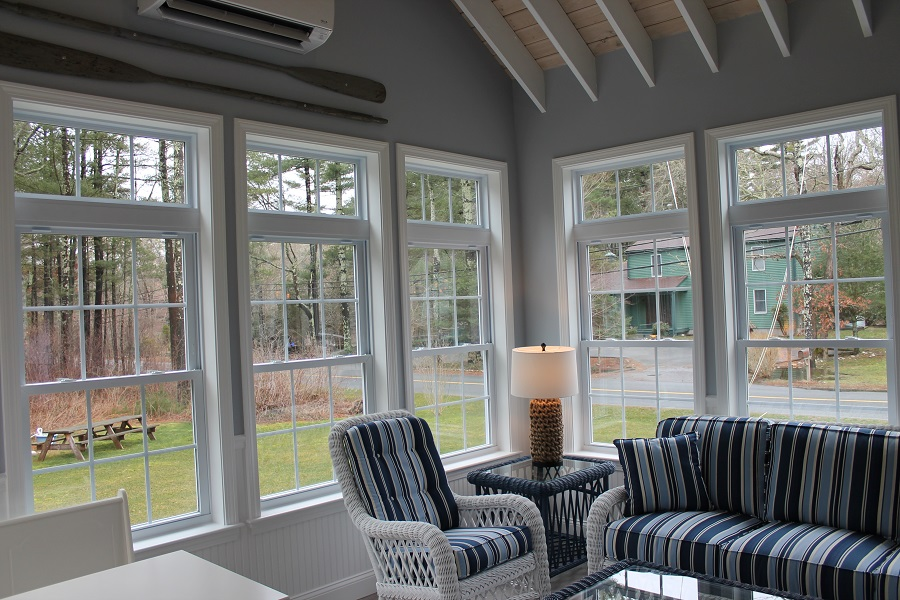 Sunroom with Exposed Rafter Ceiling Andersen Windows in Mattapoisett MA  Contractor Cape Cod