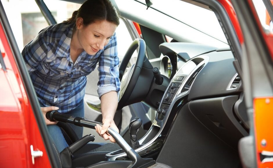 care-my-cars-woman-cleaning-interior-car-using-vacuum