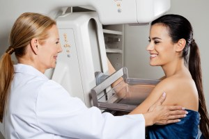 Mature,Female,Doctor,Assisting,Young,Patient,During,Mammogram,X-ray,Test