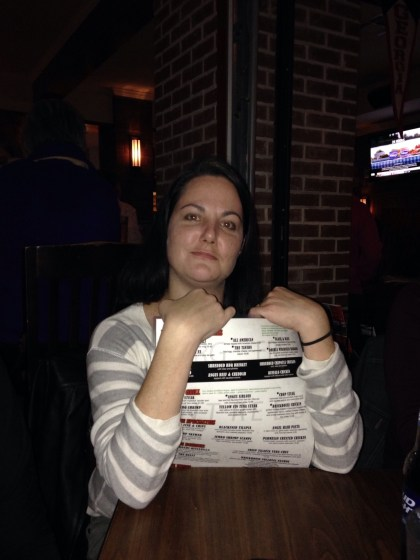 Katy hugging the menu