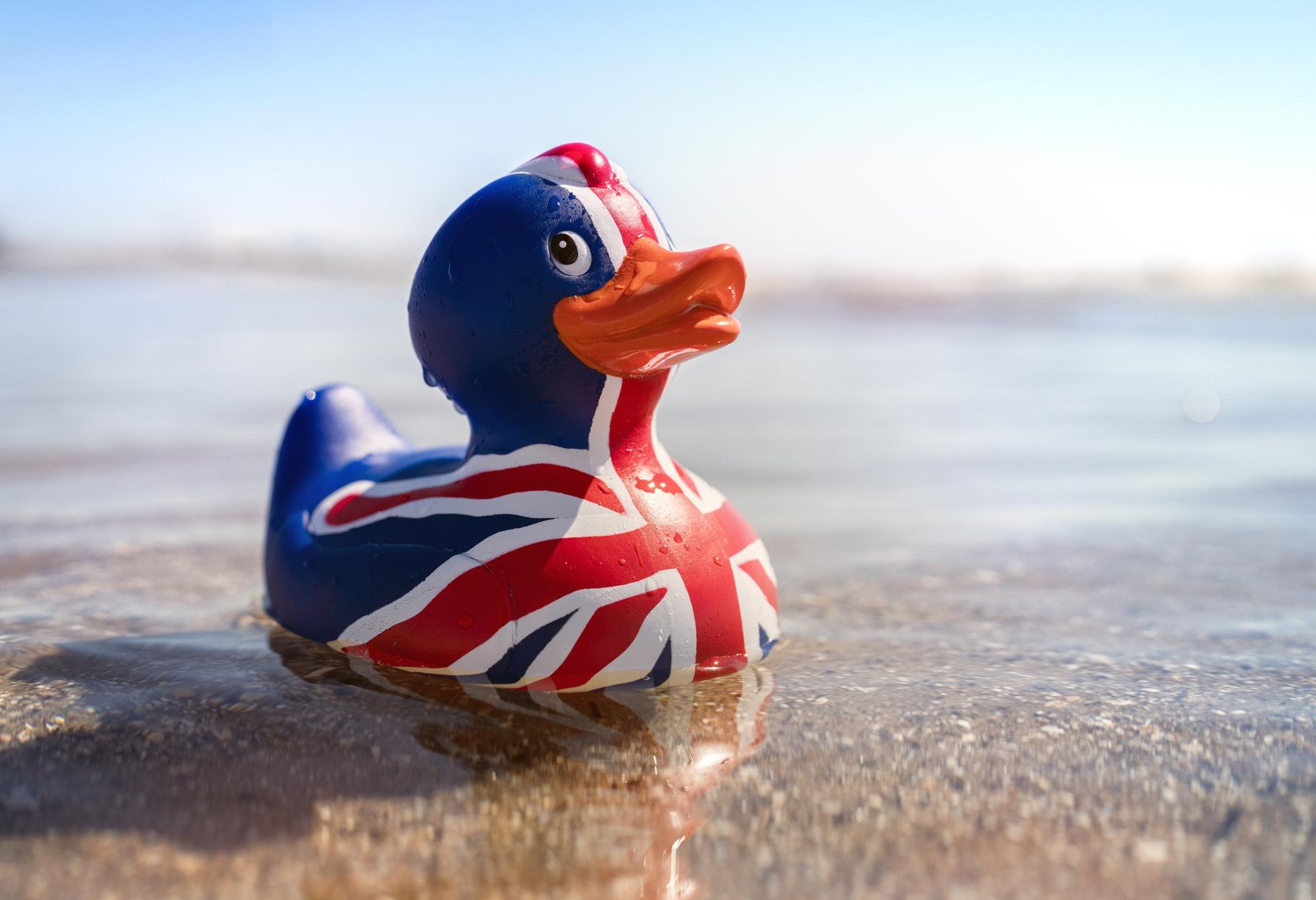 British flag rubber duck in the sea