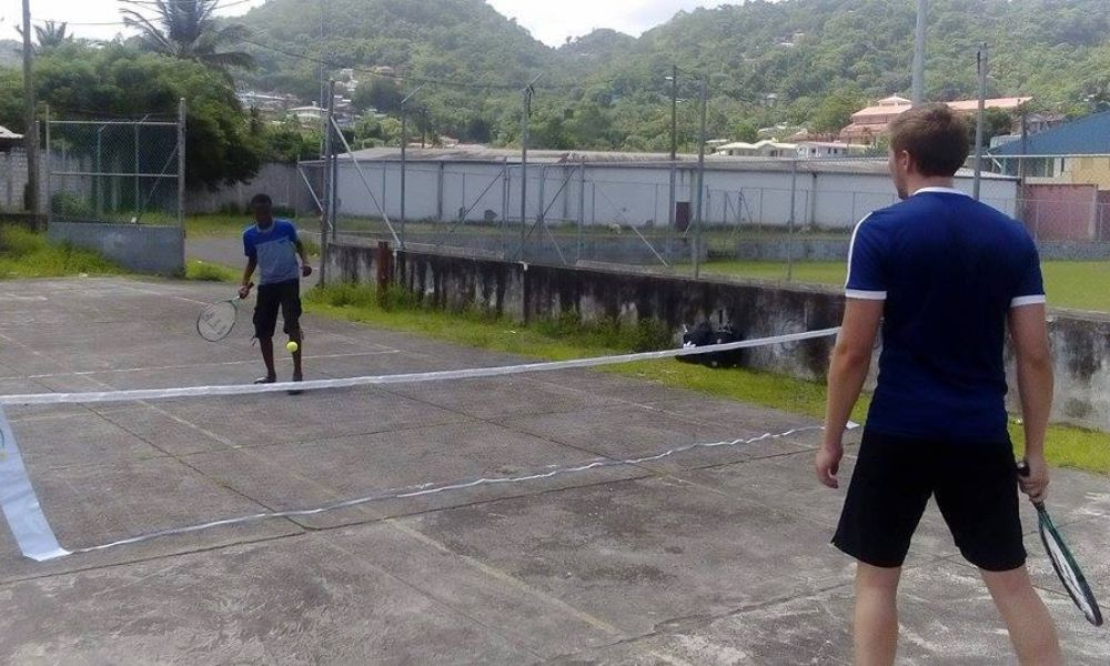 Tennis coach working in a community in St Lucia