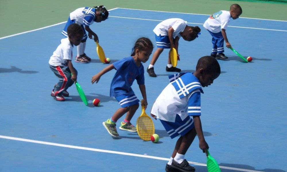 Children taking part in a tennis lesson in the Caribbean