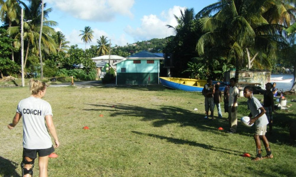 Gap year coach running a rugby session in the Caribbean