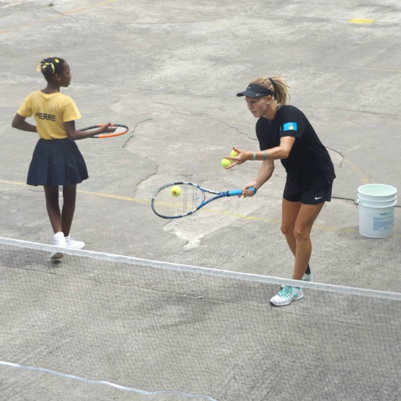 A tennis lesson in a school in St Lucia