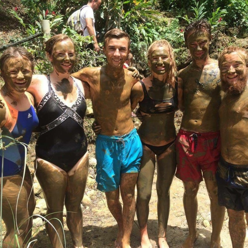Volunteers at the mud bathes in St Lucia