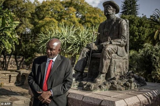 Namibian former Culture Minister Kazenambo Kazenambo stands by a statue of Chief Hosea Katjiku-Ru-Rume-Kutako as he speaks of talks and negotiations about the alleged genocide committed by German forces against Herero and Nama people in 1904.