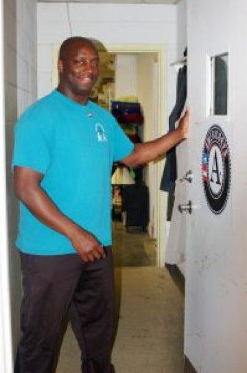 volunteer holding door open