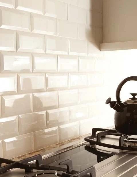 cream beveled subway tile backsplash