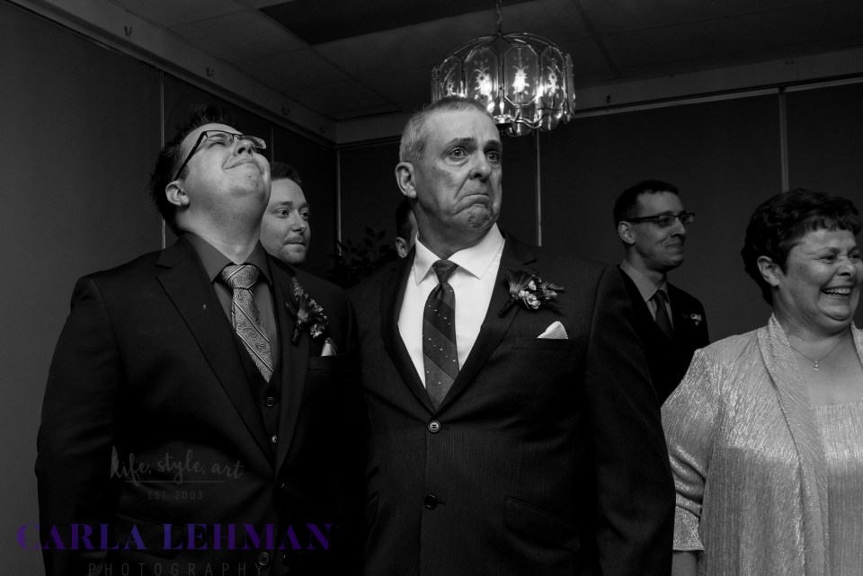 Waiting for his bride to walk down the aisle at their Camrose Alberta wedding