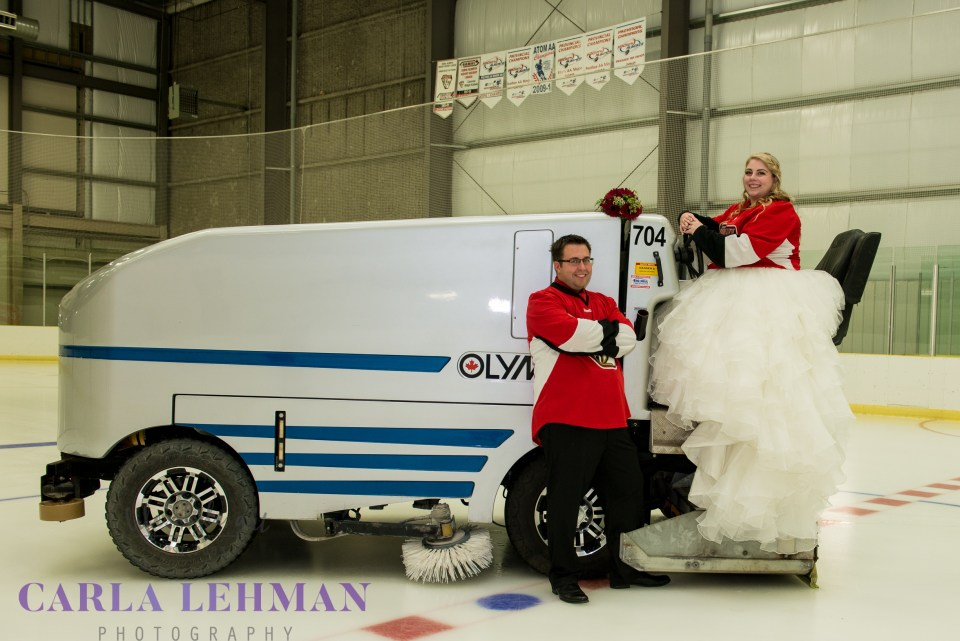 A bride and a zamboni driver for her wedding photo at the Camrose Kodiaks