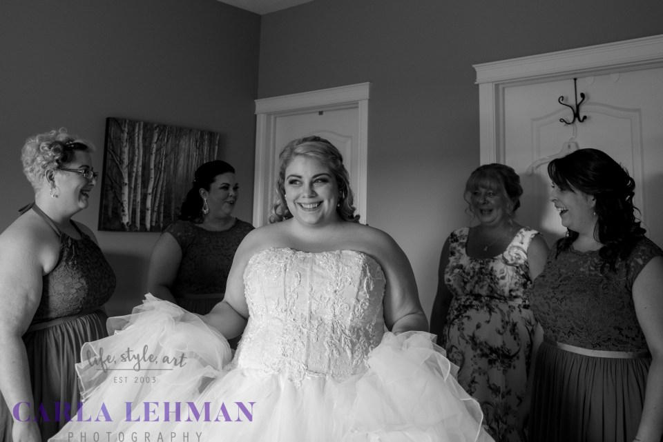 Excited little bride, in anticipation of her Camrose wedding.