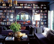 roman and williams purple living room den built in bookshelves books bookcase shelves cococozy