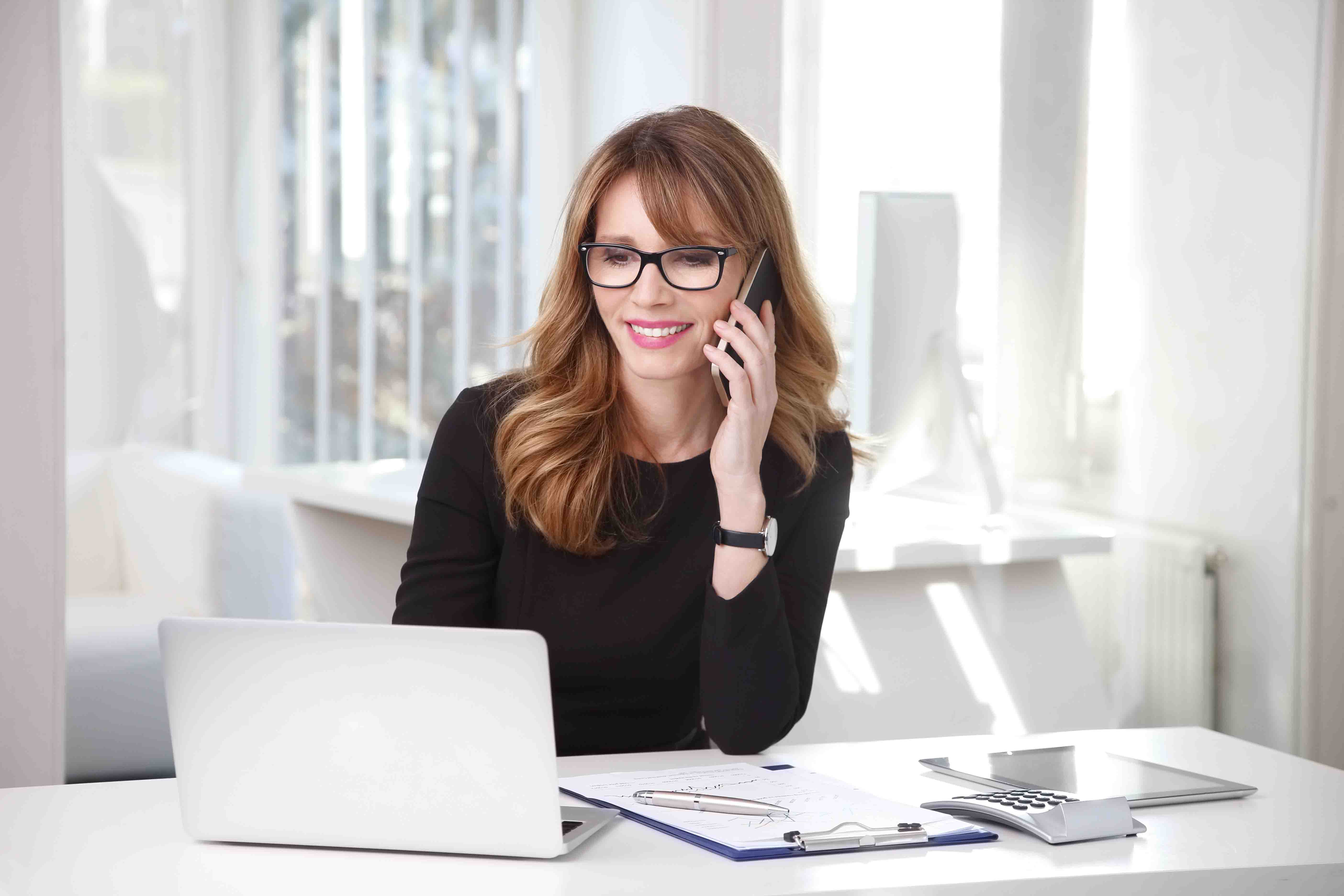 Carla Rieger Sm Work From Home Woman On Phone With Laptop