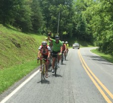 Rider Porter Peery waves from the paceline on Dillon's Mill Road.