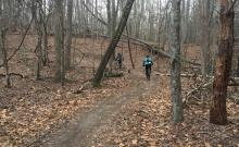 Gary Butcher and Andy Beedle ride the winter woods at Carvins Cove