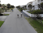 Riding among the homes along the strip at Holden Beach.
