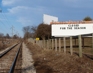 Bourbon Drive-In marquee and screen next to railroad tracks