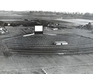 Old, black and white aerial photo of the Motor Vu in the midst of farmland