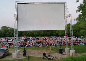 Small drive-in screen with cars at a park