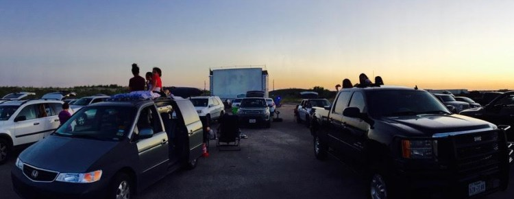 Cars at a drive-in at twilight