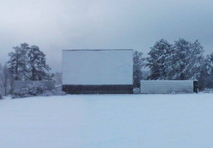 drive-in screen and fences covered in snow