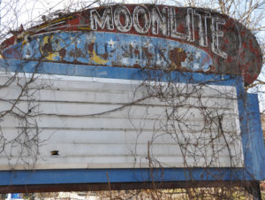 The Moonlight Drive-In marquee, overgrown with weeds