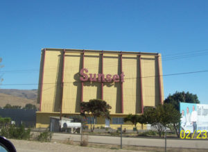 Sunset Drive-In sign on the back of its screen