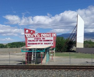 Tru Vu Drive-In marquee and screen in front of blue sky and clouds
