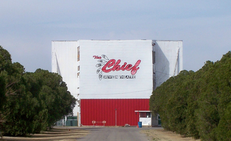 Tree-lined driveway to the back of the Chief Drive-In screen