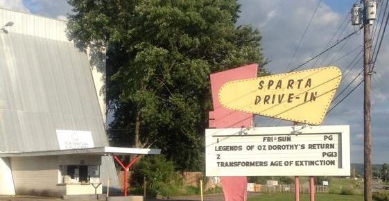 Sparta Drive-In marquee with screen, ticket booth and tree