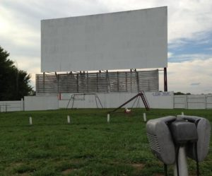 Midway Drive-In screen with car speakers in the foreground