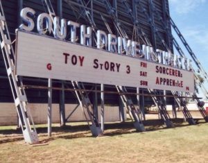 South Drive-In marquee next to a screen