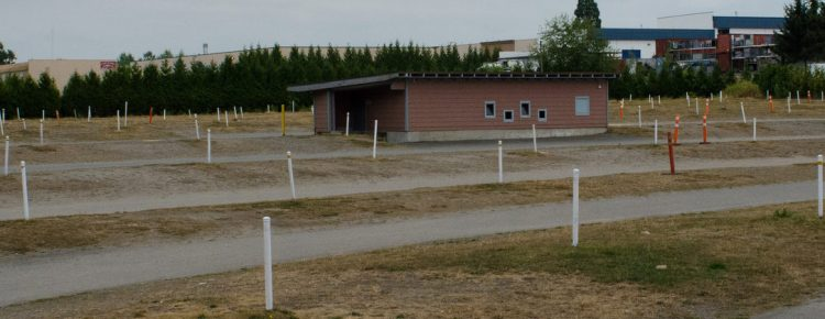 Speaker poles and the concession stand at the Starlight Drive-In