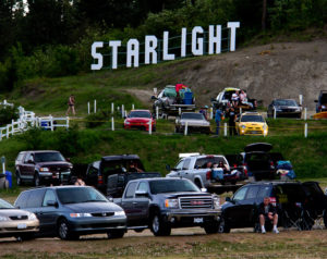 Two levels of parked cars, with Starlight spelled out behind them