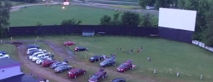 Aerial view of a screen, the concession stand, and the marquee in the distance
