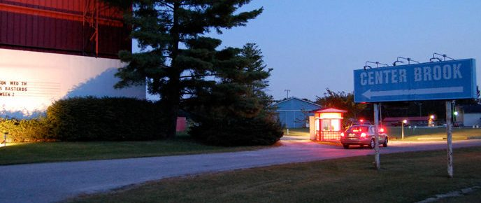 Centerbrook Drive-In sign, screen, and box office in between