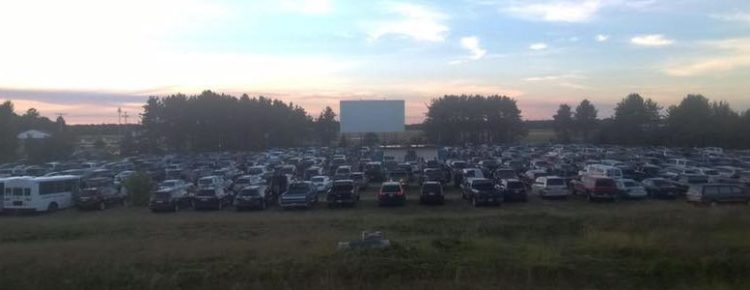 Panorama of cars in front of a drive-in screen