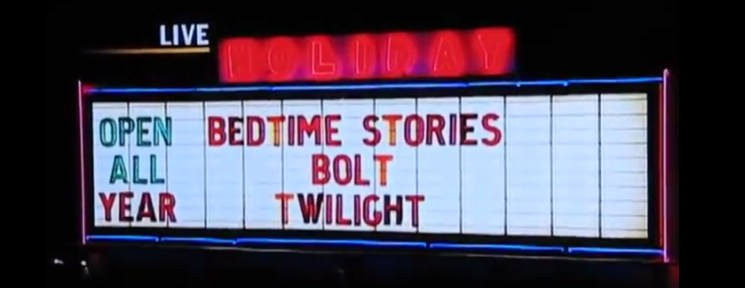 Holiday Auto Theatre marquee lit at night