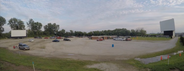 Wide-angle view of both screens at the Field of Dreams Drive-In