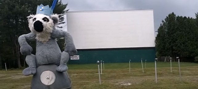 Drive-in screen with a stuffed animal in the foreground
