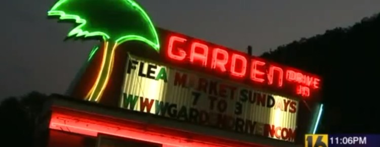 Neon-lit marquee for the Garden Drive-In