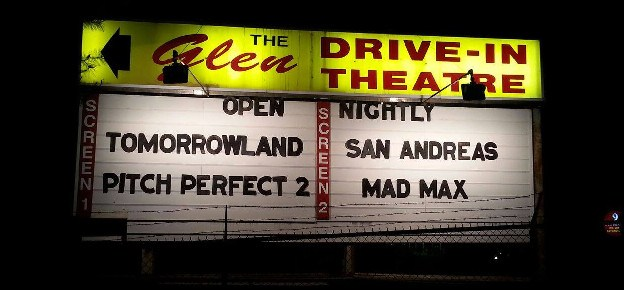 Glen Drive-In Theatre sign lit at night