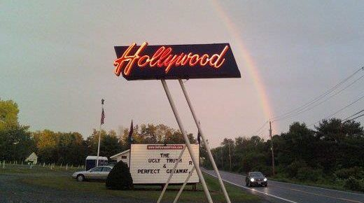Hollywood Drive-In marquee with a rainbow in the background